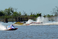 Frame 5: Terry Rinker (#10) and Chris Fairchild (#62) race up the back stright to turn 2 where Rinker's boat rolls over a wake, noses in and flips.   (Formula 1/F1/Champ class)