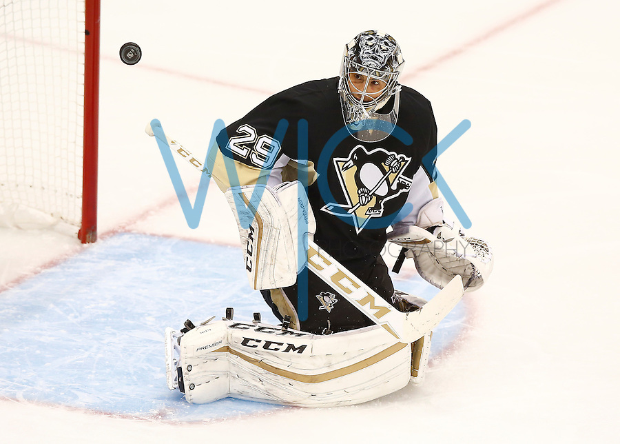 Marc Andre-Fleury #29 of the Pittsburgh Penguins makes a save in the first period against the Colorado Avalanche during the game at Consol Energy Center on November 19, 2015. (Photo by Jared Wickerham/DKPittsburghSports)