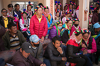 East Village, Diqing Tibetan Autonomous Prefecture, Yunnan Province, China - Tibetan villagers watch traditional Xianzi Dance, February 2017.