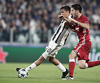 Football Soccer: UEFA Champions League Juventus vs Olympiacos Allianz Stadium. Turin, Italy, September 27, 2017. <br /> Juventus' Paulo Dybala (l) in action with Olympiacos' Sasa Zdjelar (r) during the Uefa Champions League football soccer match between Juventus and Olympiacos at Allianz Stadium in Turin, September 27, 2017.<br /> UPDATE IMAGES PRESS/Isabella Bonotto