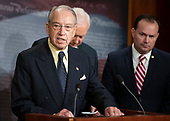 United States Senator Chuck Grassley (Republican of Iowa), left, makes remarks at a Republican press conference in the US Capitol in Washington, DC after members of the US Senate viewed the latest FBI report on Judge Brett Kavanaugh on Thursday, October 4, 2018. Standing behind Grassley are US Senator Orrin Hatch (Republican of Utah), center, and US Senator Mike Lee (Republican of Utah).<br /> Credit: Ron Sachs / CNP<br /> (RESTRICTION: NO New York or New Jersey Newspapers or newspapers within a 75 mile radius of New York City)