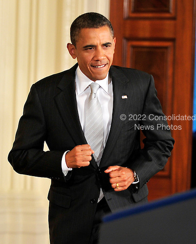 United States President Barack Obama seems to run to the podium to deliver remarks on the National HIV/AIDS Strategy in the East Room of the White House in Washington, D.C. on Tuesday, July 13, 2010..Credit: Ron Sachs - Pool via CNP