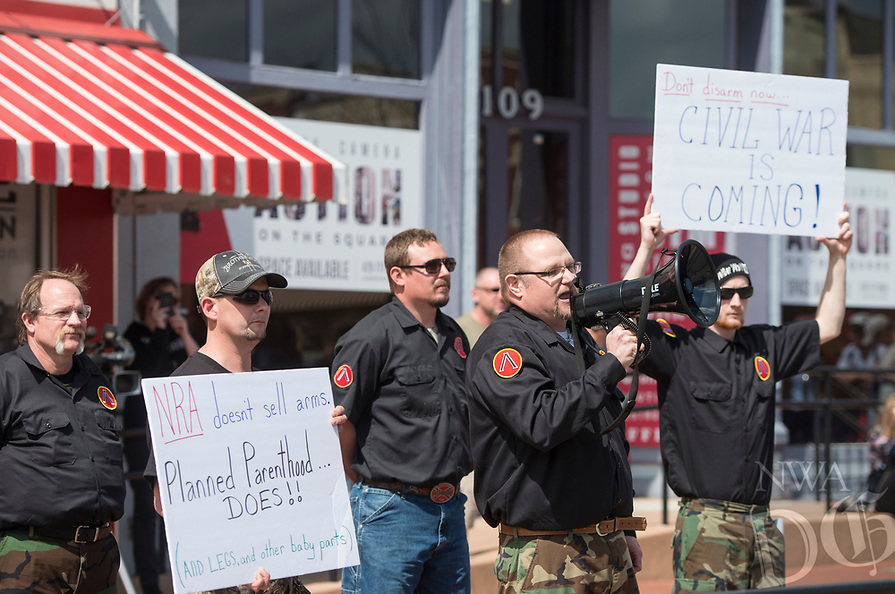 NWA Democrat-Gazette/BEN GOFF @NWABENGOFF<br /> Billy Roper (with megaphone) and other members of the ShieldWall Network, a self-described 'grassroots organizing' of 'white nationalist preppers' based out of Mountain View counter protest in support of gun rights Saturday, March 24, 2018, during for a March for our Lives event on the Bentonville square.