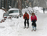 Beacon Hill residents Spencer and Lisa Macalaster ski race down Pinckney Street in Boston as a major winter storm that produced blizzard conditions winds down in Boston on Tuesday, January 27, 2015. Photo by Christopher Evans
