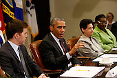 United States President Barack Obama (2L) meets with small business owners to discuss the importance of the reauthorization of the Export-Import Bank in the Roosevelt Room of the White House on July 22, 2015, in Washington, DC while Paul Sullivan (L), Vice President of International Business Development Acrow Bridges,  and Susan Jaime (3L), Founder Ferra Coffee, listen.  <br /> Credit: Aude Guerrucci / Pool via CNP