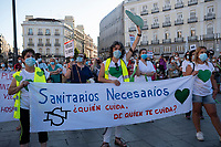 MADRID, SPAIN - JUNE 29: Protesters holding a banner during a protest held in the afternoon in Puerta del Sol to request better working conditions, protection equipment and investment in Health to fight against the covid-19 on June 29 2020, in Madrid, Spain. The region of Madrid was the main focus of covid-19 outbreak in Spain. In al over the country, more than 50000 thousand health staff has been infected with the coronavirus since the beginning of the pandemic.(Photo by Sergio Belena/VIEWpress via Getty Images).