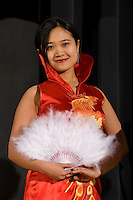 A young woman holds up a Chinese fan during a Chinese New Year Celebration at UNC Charlotte in Charlotte, NC.