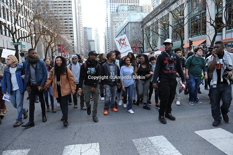 Protesters calling on Chicago Mayor Rahm Emanuel to resign march up Michigan Avenue in the Loop in Chicago, Illinois on December 9, 2015.  Emanuel offered a historic apology for the police killing of Laquan McDonald and police brutality and racial profiling generally -- without using those words -- in front of the City Council in the morning.