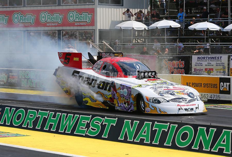Aug. 2, 2014; Kent, WA, USA; NHRA funny car driver Cruz Pedregon during qualifying for the Northwest Nationals at Pacific Raceways. Mandatory Credit: Mark J. Rebilas-