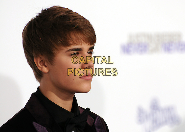 "JUSTIN BIEBER.""Justin Bieber: Never Say Never"" Los Angeles Premiere held at Nokia Theater L.A. Live, Los Angeles, California, USA, .8th February 2011..portrait headshot side profile black shirt  velvet jacket brown purple .CAP/ADM/BP.©Byron Purvis/AdMedia/Capital Pictures."
