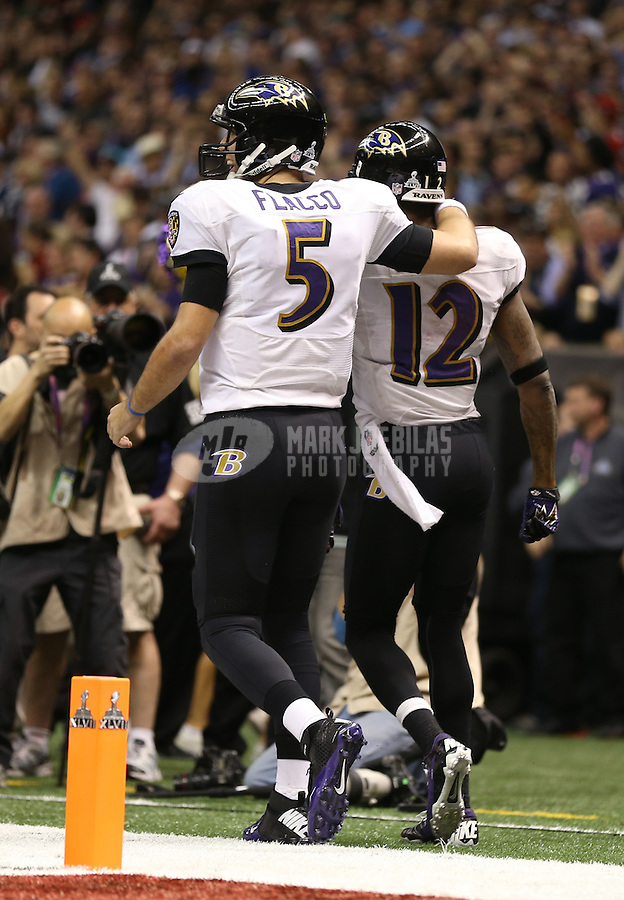 Feb 3, 2013; New Orleans, LA, USA; Baltimore Ravens wide receiver Jacoby Jones (12) celebrates with quarterback Joe Flacco (5) after scoring a touchdown against the San Francisco 49ers in the second quarter in Super Bowl XLVII at the Mercedes-Benz Superdome. Mandatory Credit: Mark J. Rebilas-