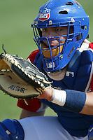 Rene Rivera of the Inland Empire 66ers catches in the bullpen before a 2004 season California League game at San Manuel Stadium in San Bernardino, California. (Larry Goren/Four Seam Images)