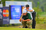 29 August 2009: Steve Marino and his caddie line up a putt during the third round of The Barclays PGA Playoffs at Liberty National Golf Course in Jersey City, New Jersey.