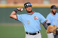 First baseman Jose Almonte (9) of the Hickory Crawdads warms up before a game against the Greenville Drive on Wednesday, May 15, 2019, at Fluor Field at the West End in Greenville, South Carolina. Greenville won, 6-5. (Tom Priddy/Four Seam Images)