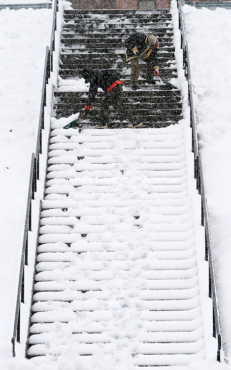 SOUTHBURY, CT 03 January 2005 -010305BZ02- Workers, who would not give their names, clear stairs at Pomperaug High School in Southbury Tuesday afternoon.   <br /> Jamison C. Bazinet Republican-American