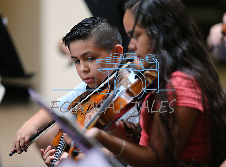Ricky Becerra, 8, and his sister Vanessa, 12, perform in the Carson City Symphony's Youth Strings Summer Program concert in Carson City, Nev., on Thursday, July 27, 2017. <br />Photo by Cathleen Allison