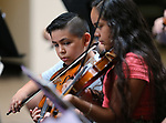 Ricky Becerra, 8, and his sister Vanessa, 12, perform in the Carson City Symphony's Youth Strings Summer Program concert in Carson City, Nev., on Thursday, July 27, 2017. <br />