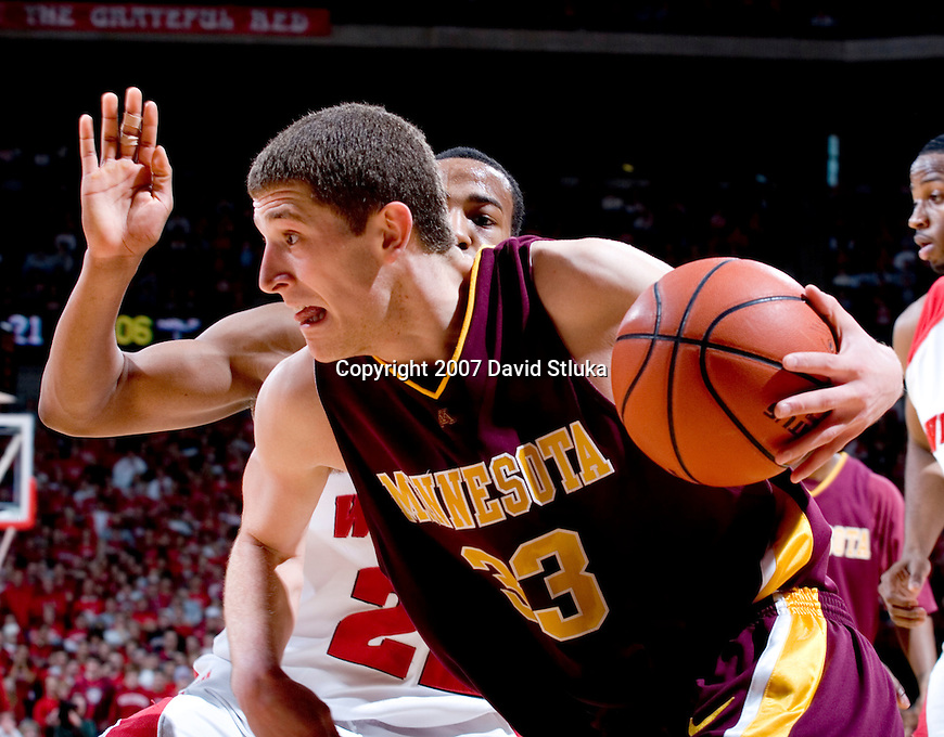 MADISON, WI - JANUARY 6: Guard Michael Flowers #22 of the Wisconsin Badgers defends against guard Jamal Abu-Shamala #33 of the Minnesota Golden Gophers at the Kohl Center on January 6, 2007 in Madison, Wisconsin. The Badgers beat the Golden Gophers 68-45. (Photo by David Stluka)