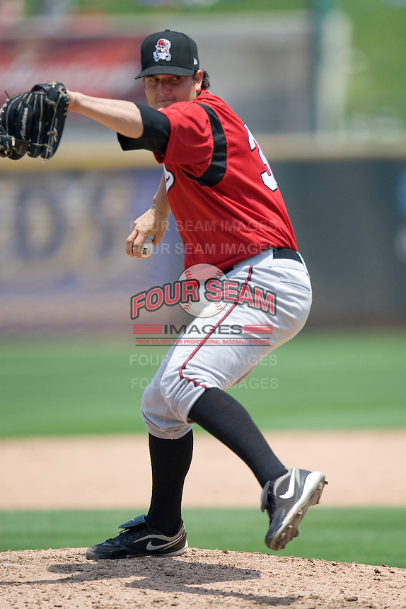 Nashville Sounds pitcher Donovan Hand #30 delivers against the Round Rock Express in Pacific Coast League baseball on May 9, 2011 at the Dell Diamond in Round Rock, Texas. (Photo by Andrew Woolley / Four Seam Images)