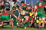 Mark Price struggles to break out of Tevita Finau's tackle. Counties Manukau Premier Club Rugby game between Pukekohe and Waiuku played at Colin Lawrie Fields, Pukekohe, on Saturday July 3rd 2010. Pukekohe won 31 - 12 after leading 15 - 9 at halftime.