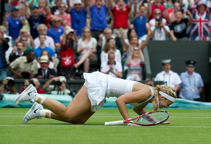 Sabine Lisicki (GER) falls to the floor and celebrates her victory over Serena Williams (USA) in their Ladies' Singles Fourth Round match today - Sabine Lisicki (GER) [23] def Serena Williams (USA) [1] 6-2 1-6 6-4<br /> <br />  (Photo by Stephen White/CameraSport) <br /> <br /> Tennis - Wimbledon Lawn Tennis Championships - Day 7 Monday 1st July 2013 -  All England Lawn Tennis and Croquet Club - Wimbledon - London - England<br /> <br /> &copy; CameraSport - 43 Linden Ave. Countesthorpe. Leicester. England. LE8 5PG - Tel: +44 (0) 116 277 4147 - admin@camerasport.com - www.camerasport.com.