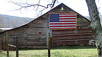 NWA Democrat-Gazette/FLIP PUTTHOFF <br /> A barn along Arkansas 215 catches the eye March 26 2017 with an American Flag.