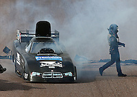 Feb 21, 2015; Chandler, AZ, USA; NHRA funny car driver Shane Westerfield walks from his car after suffering an engine fire during qualifying for the Carquest Nationals at Wild Horse Pass Motorsports Park. Mandatory Credit: Mark J. Rebilas-