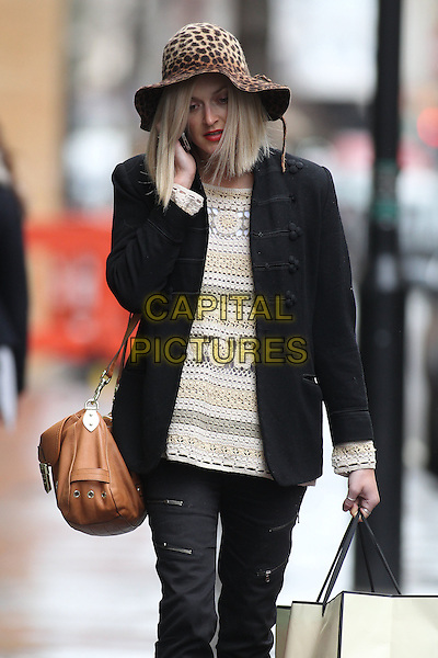 Fearne Cotton leaving the BBC Radio 1 studios, London, England..January 20th, 2011.half length black coat jacket trousers brown leopard print hat white cream beige top bag purse talking on mobile phone crochet.CAP/CAN.©Can Nguyen/Capital Pictures.