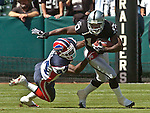 Buffalo Bills defensive back Terrence McGee (24) attempts to tackle Oakland Raiders wide receiver Carlos Francis (10) on Sunday, September 19, 2004, in Oakland, California. The Raiders defeated the Bills 13-10.