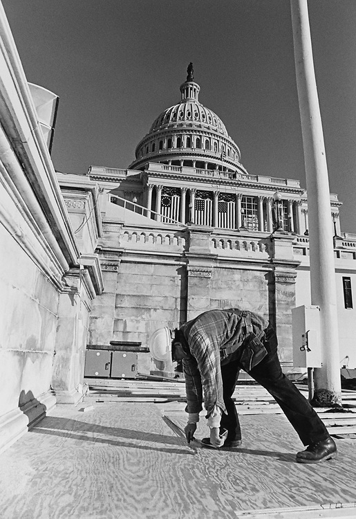 Architecture of Capitol Dave Malott working on space for extra VIP seating just added at inaugural construction, in 1997. (Photo by Rebecca Roth/CQ Roll Call via Getty Images)