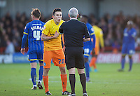 Luke O'Nien of Wycombe Wanderers asks Referee Philip Gibbs why he is being booked during the Sky Bet League 2 match between AFC Wimbledon and Wycombe Wanderers at the Cherry Red Records Stadium, Kingston, England on 21 November 2015. Photo by Alan  Stanford/PRiME.