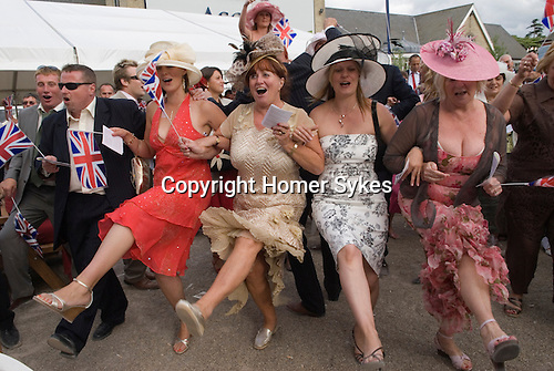 Singing around the bandstand at the end of the days racing. Horse racing at Royal Ascot, Berkshire, England. 2006.