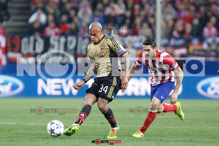 Atletico de Madrid´s Koke (R) and Milan´s Nigel de Jong during 16th Champions League soccer match at Vicente Calderon stadium in Madrid, Spain. March 11, 2014. (ALTERPHOTOS/Victor Blanco)