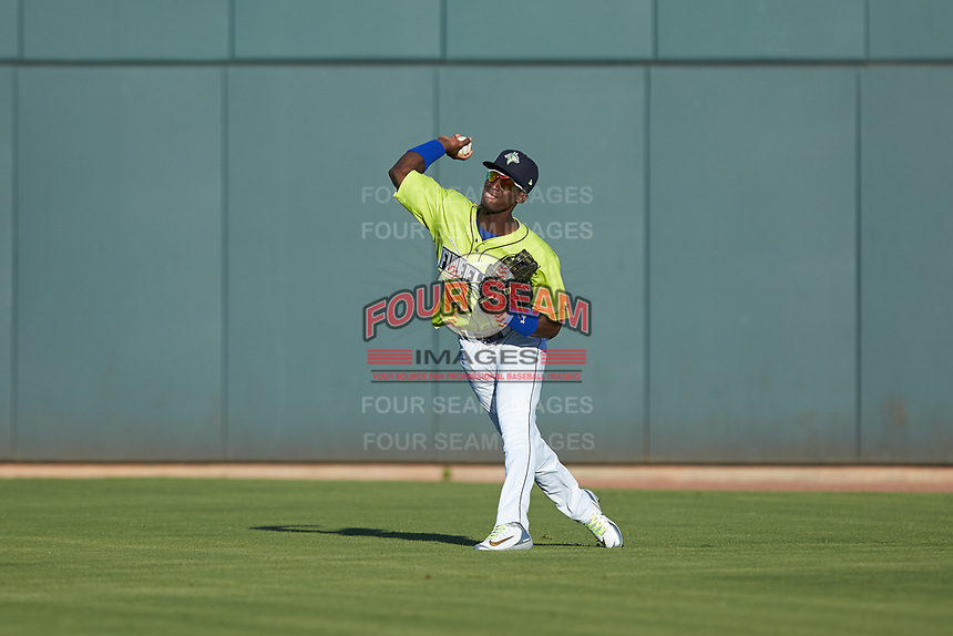 Columbia Fireflies right fielder Yoel Romero (19) throws the ball back to the infield during the game against the Rome Braves at Segra Park on May 13, 2019 in Columbia, South Carolina. The Fireflies walked-off the Braves 2-1 in game one of a doubleheader. (Brian Westerholt/Four Seam Images)