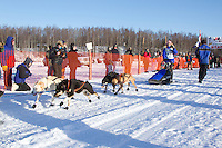 Alea Robinson leaves the start line of the Junior Iditarod  at Knik Lake, Knik, Alaska