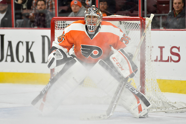 29 January 2015: Philadelphia Flyers goalie Steve Mason (35) looks for the puck against the Winnipeg Jets during the third period at the Wells Fargo Center. The Flyers won 5-2.