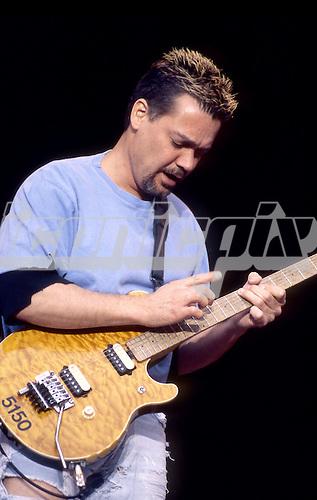 Van Halen - guitarist Eddie Van Halen peforming live at Wembley Stadium, London UK - 25 Jun 1995.   Photo credit: George Chin/IconicPix