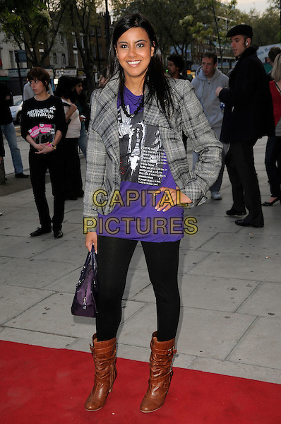 """POOJA SHAH.The """"City Rats"""" East End Film Festival VIP Screening, Genesis Cinema, Mile End Road, London, England..April 24th 2009.full length purple top checked plaid grey gray black jacket legging brown boots bag hand on hip .CAP/CAS.©Bob Cass/Capital Pictures."""