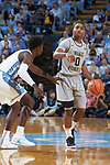 Brandon Childress (0) of the Wake Forest Demon Deacons brings the ball up the court while being defended by Jalek Felton (5) of the North Carolina Tar Heels during first half action at the Dean Smith Center on December 30, 2017 in Chapel Hill, North Carolina.  The Tar Heels defeated the Demon Deacons 73-69.  (Brian Westerholt/Sports On Film)