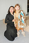 Fashion designer poses with child model during the petiteTALKS panel discussion on at the Javits Center in New York City on January 07, 2018.