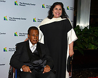 Wayne Shorter and his wife Carolina dos Santos Shorter, arrive for the formal Artist's Dinner honoring the recipients of the 41st Annual Kennedy Center Honors hosted by United States Deputy Secretary of State John J. Sullivan at the US Department of State in Washington, D.C. on Saturday, December 1, 2018. The 2018 honorees are: singer and actress Cher; composer and pianist Philip Glass; Country music entertainer Reba McEntire; and jazz saxophonist and composer Wayne Shorter. This year, the co-creators of Hamilton, writer and actor Lin-Manuel Miranda, director Thomas Kail, choreographer Andy Blankenbuehler, and music director Alex Lacamoire will receive a unique Kennedy Center Honors as trailblazing creators of a transformative work that defies category.<br /> CAP/MPI/RS<br /> &copy;RS/MPI/Capital Pictures