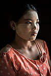 Shwethaungyan Township. <br /> <br /> Padauk Wah works as a daily wager in construction in Magyi, Myanmar. Like most people here, she has applied a cosmetic paste of ground wood, roots and water to her face and arms called Tanakha, which is meant to soften skin heal and prevent acne as well as sunburn.