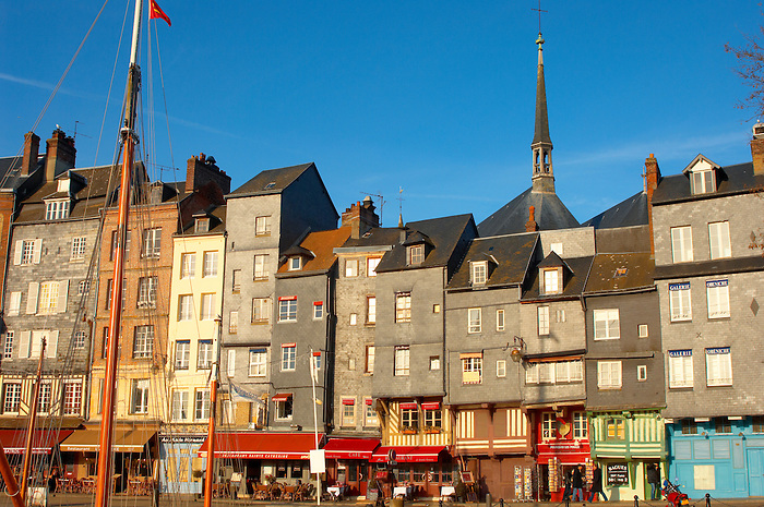 harbour side restaurants and houses. Honfleur, Normandy, France.