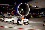 A ground crew member drives a cart with pallets to unload cargo onto after the arrival of a Delta 777 flight from Johannesburg, South Africa at Gate F8 outside of the Maynard H. Jackson Jr. International Terminal at Hartsfield–Jackson Atlanta International Airport, in Atlanta, Georgia on August 28, 2013.