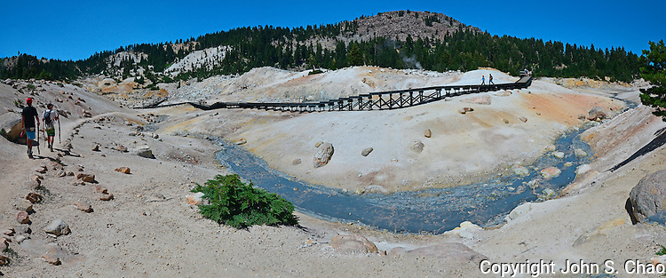 Bumpass Hell panoramic view of trail and boardwalk in colorful hydrothermal area, Lassen Volcanic National Park, California
