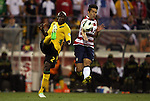 11 September 2012: Nyron Nosworthy (JAM) (2) clears the ball past Herculez Gomez (USA) (9). The United States Men's National Team defeated the Jamaica Men's National Team 1-0 at Columbus Crew Stadium in Columbus, Ohio in a CONCACAF Third Round World Cup Qualifying match for the FIFA 2014 Brazil World Cup.