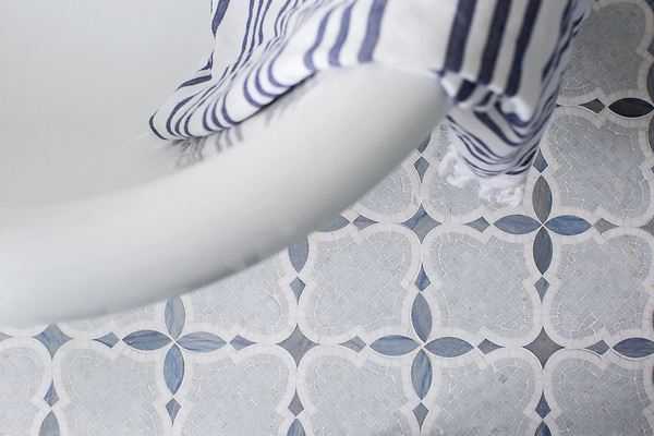 Aiden®, a natural stone mosaic shown in polished and honed Celeste with polished Blue Macauba and Thassos is part of New Ravenna's Studio Line. All mosaics in this collection are ready to ship within 48 hours.<br /> <br /> - bath designed by Urban Grace Interiors<br /> - photo courtesy of Framework Photography