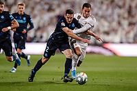 23rd November 2019; Estadio Santiago Bernabeu, Madrid, Spain; La Liga Football, Real Madrid versus Real Sociedad; Joseba Zaldua (Real Sociedad) tussles with Eden Hazard (Real Madrid) - Editorial Use