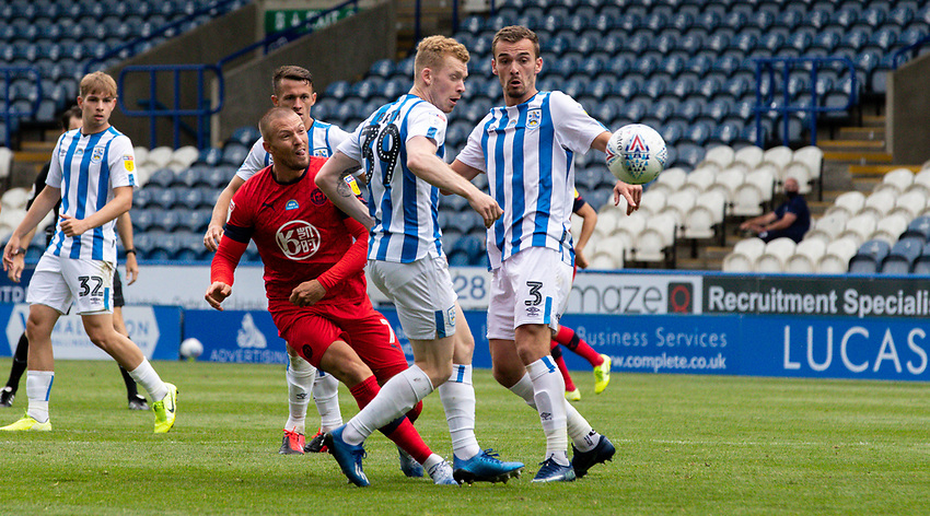 Wigan Athletic's Anthony Pilkington scores his side's second goal<br /> <br /> Photographer Alex Dodd/CameraSport<br /> <br /> The EFL Sky Bet Championship - Huddersfield Town v Wigan Athletic - Saturday 20th June 2020 - John Smith's Stadium - Huddersfield <br /> <br /> World Copyright © 2020 CameraSport. All rights reserved. 43 Linden Ave. Countesthorpe. Leicester. England. LE8 5PG - Tel: +44 (0) 116 277 4147 - admin@camerasport.com - www.camerasport.com
