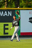 Jesus Ugueto (40) of the Pulaski Mariners catches a fly ball in left field during the Appalachian League game against the Burlington Royals at Burlington Athletic Park on June20 2013 in Burlington, North Carolina.  The Royals defeated the Mariners 2-1 in 13 innings.  (Brian Westerholt/Four Seam Images)